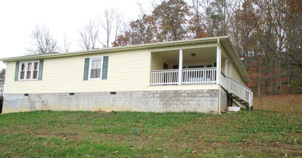 SOLD!  3.3 acres with road frontage on Hwy 511 and a frame house (1800sf) with 3 bdrms, 2 baths