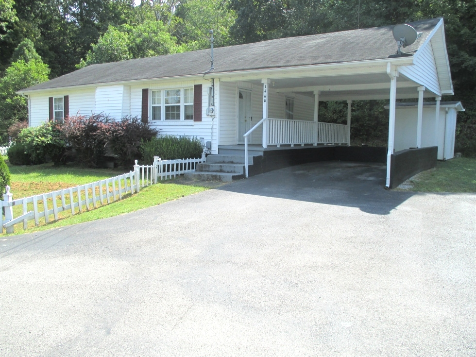 Sold 1460 Hwy 25W, Wmsbg | A two bedrooms, one bath, eat-in-kitchen, living room, laundry room, and a large walk in closet